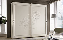 Wardrobe with 2 sliding doors, antique white finish silver frame edging and stucco decorations.