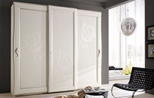 Wardrobe with 3 sliding doors, antique white finish silver frame edging and stucco decorations.